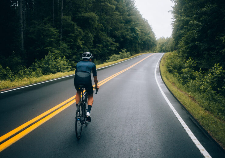 Cyclist man riding a bike on the road go to target for design or decorate cycling sport, business, finance, bangking